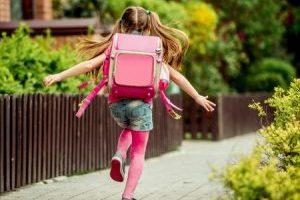 little girl runs to school