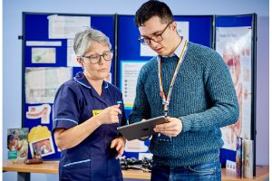 two nhs colleagues in conversation